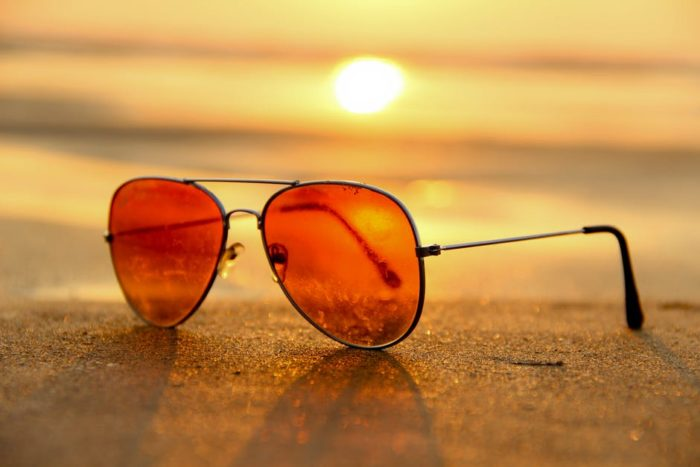 sunglasses on beach in sunset