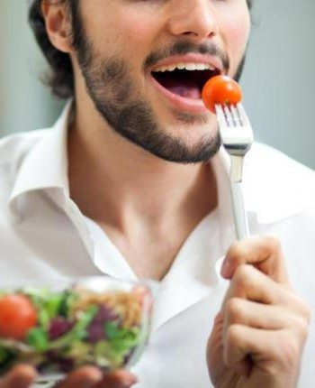 man-in-white-shirt-eating-salad