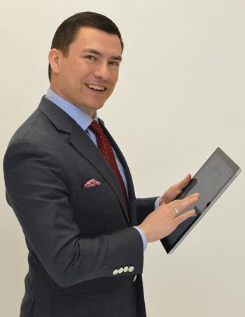Antonio holding a tablet