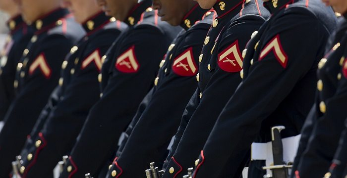 "The United States Marine Corps Silent Drill Platoon performs close order drill for The Official Battle Color Ceremony on the parade field, at Marine Corps Support Facility New Orleans, La., March 17, 2015. The Official Battle Color Ceremony features ""The Commandant's Own."" The United States Marine Drum & Bugle Corps, The United States Marine Corps Silent Drill Platoon, and the Official Color Guard of the Marine Corps are touring across the United States to demonstrate the discipline, professionalism, and ""Esprit de Corps"" of the United States Marines. (U.S. Marine Corps Photo by Lance Cpl. Issac Velasquez/Released)"