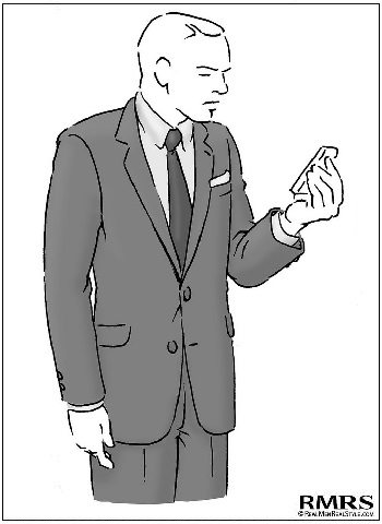 A smartly dressed man looking at his phone