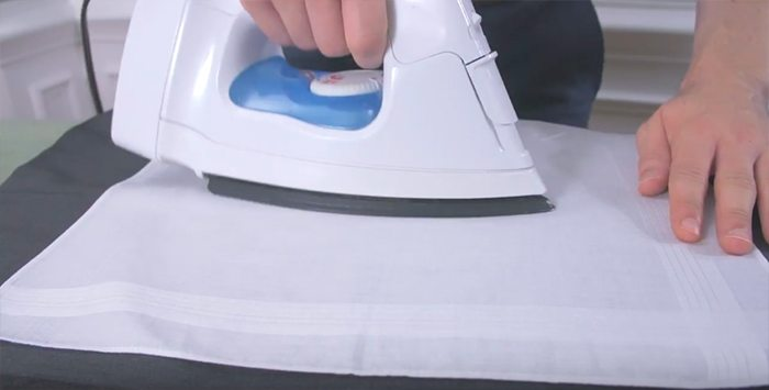 press a man's suit jacket pressing cloth