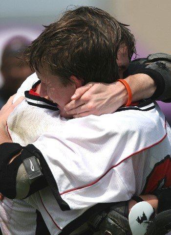 two-men-hugging