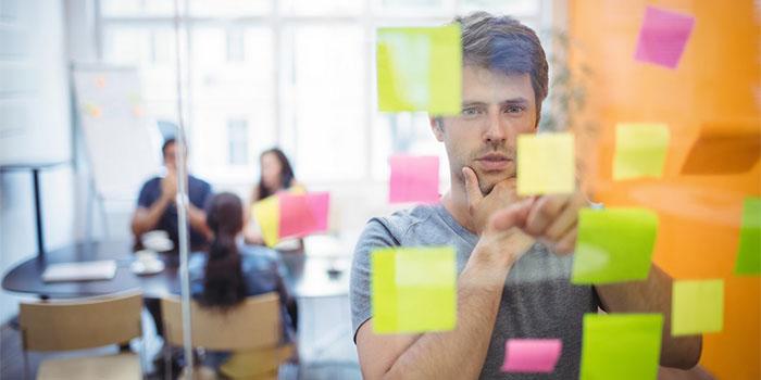 man thinking at a meeting