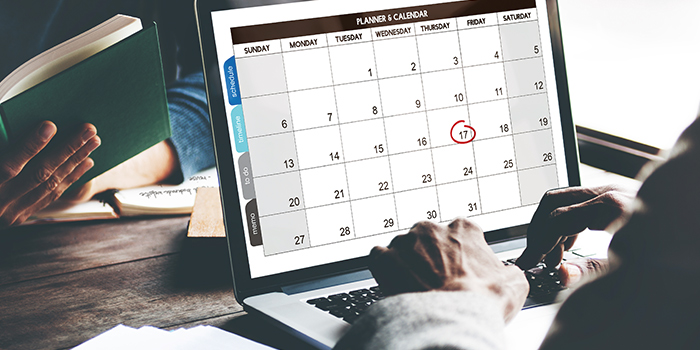 man scheduling his calendar