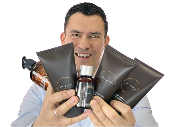 Antonio holding Vitaman products