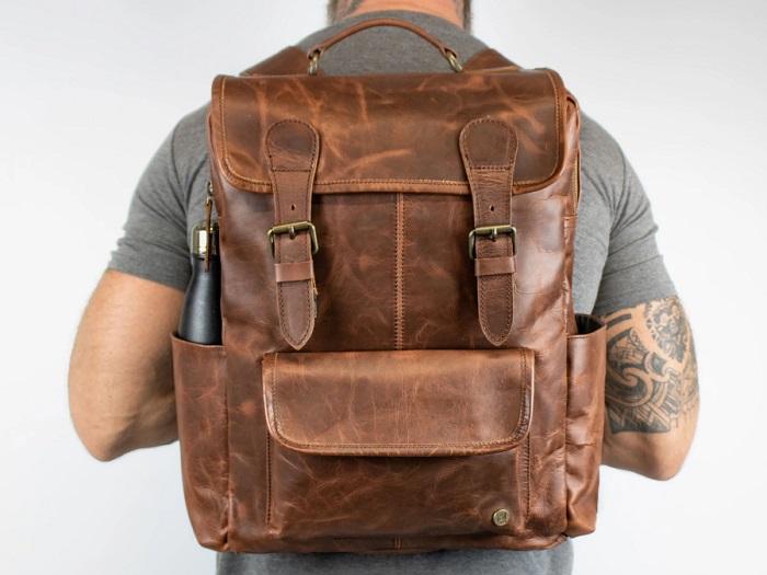 man wearing mahi backpack