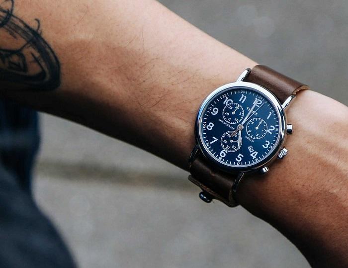 man wearing Timex watch