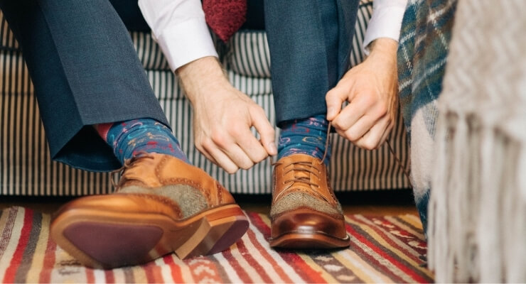 Man ties the laces on smart shoes