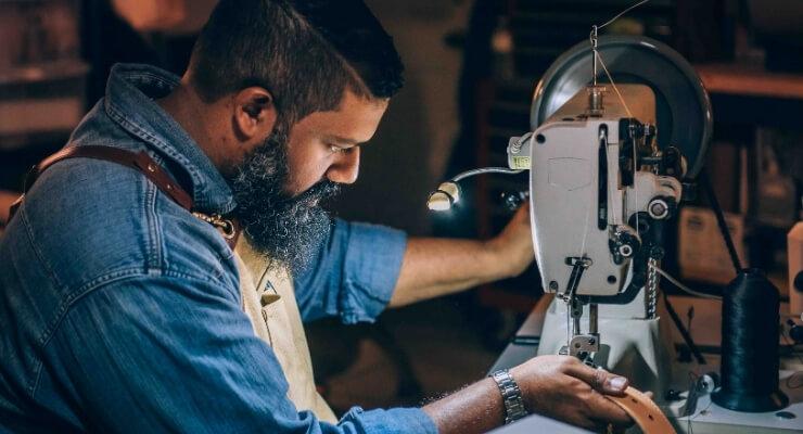 men's tailor works on belt