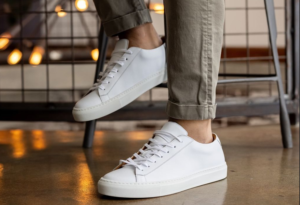 man in his 30s wearing white dress sneakers