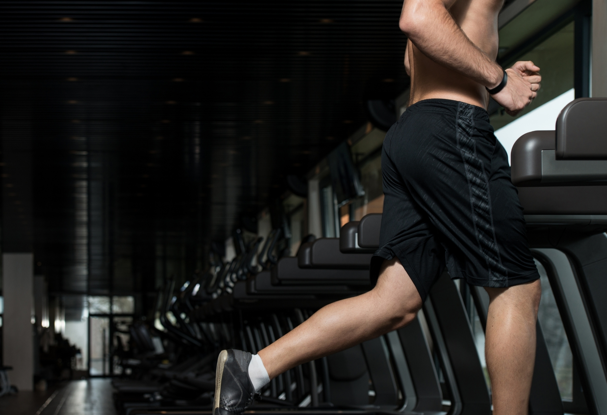 man wearing shorts at the gym