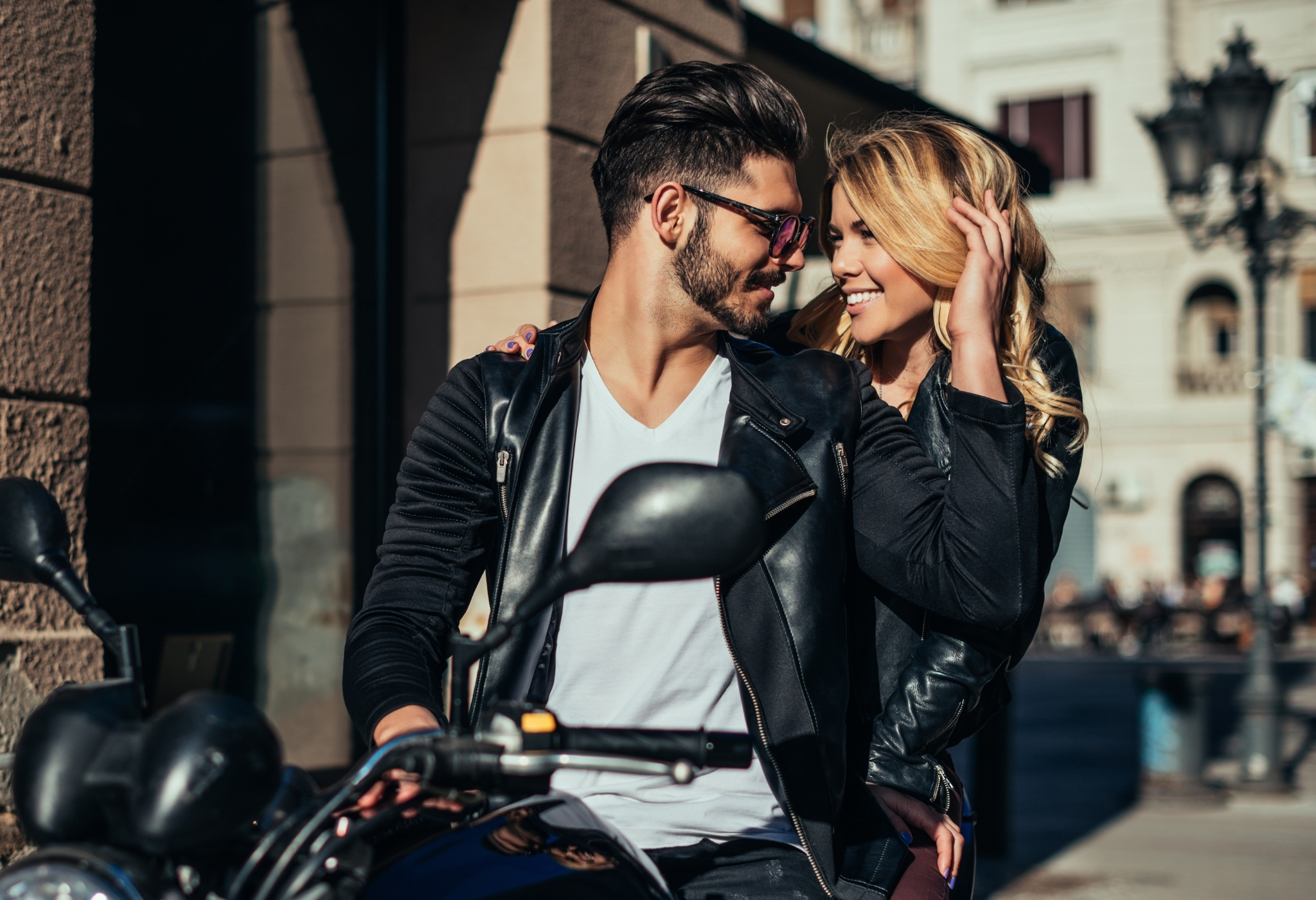 an attractive guy on a motorbike with a woman