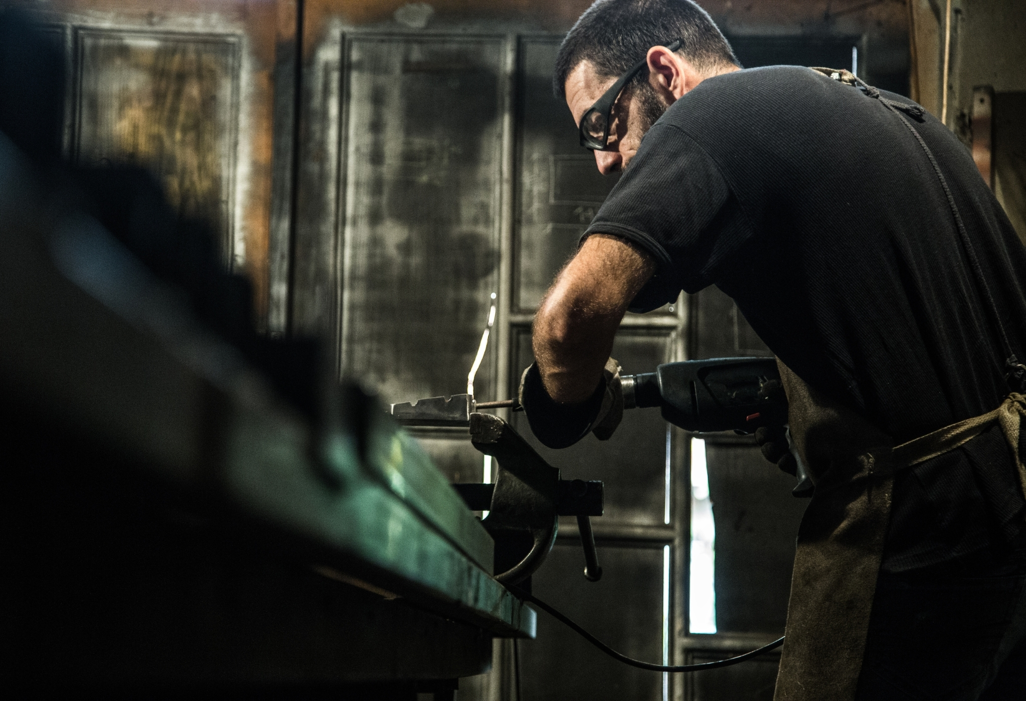 man working hard with manual tools