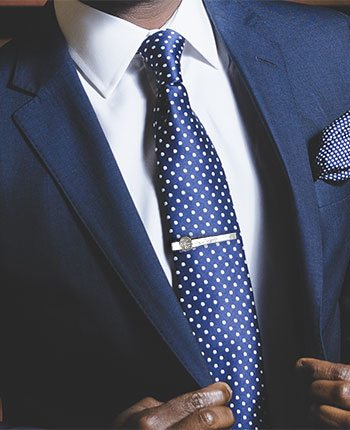 How to wear a tie clip and where to buy one the first tie bars were really just u shaped pieces of metal that were going in and holding them in place ccuart Images